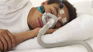 Man using CPAP Machine for Sleep Apnea